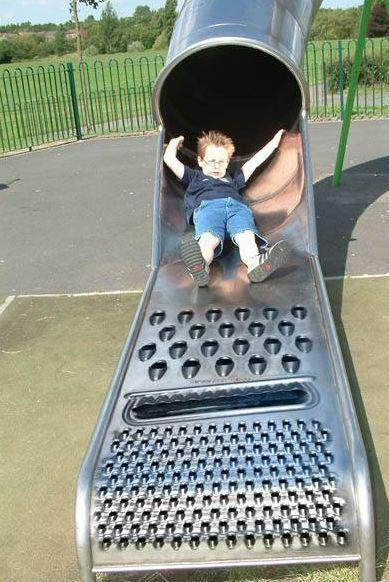 boy slides down a cheese grater