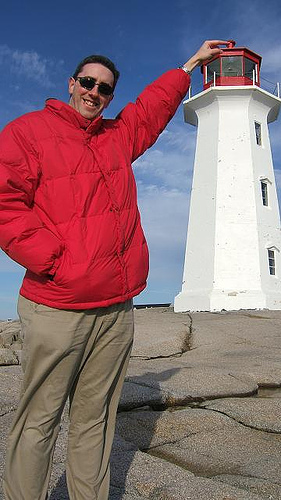 man is as tall as light house