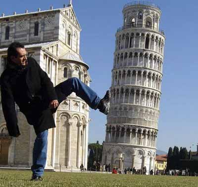 man kicks leaning tower of pisa