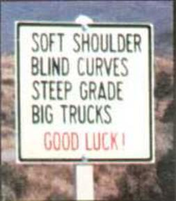 soft shoulders blind curves sign