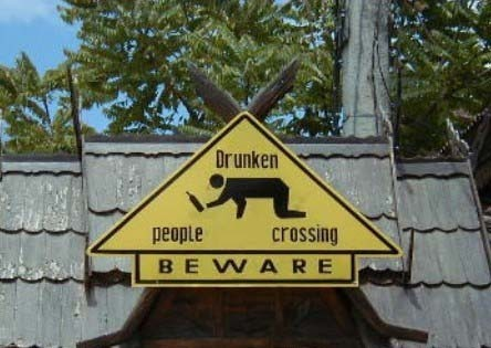 drunken people crossing beware sign