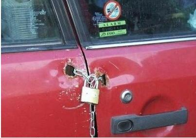 car door is locked by padlock