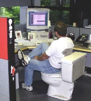 man uses toilet for computer chair