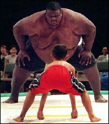 boy fights giant sumo wrestler