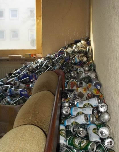tons of beer cans behind couch