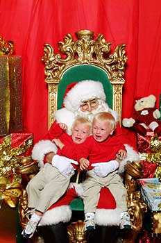 crying kids on santa's lap