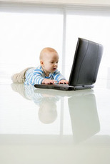 baby on laptop computer